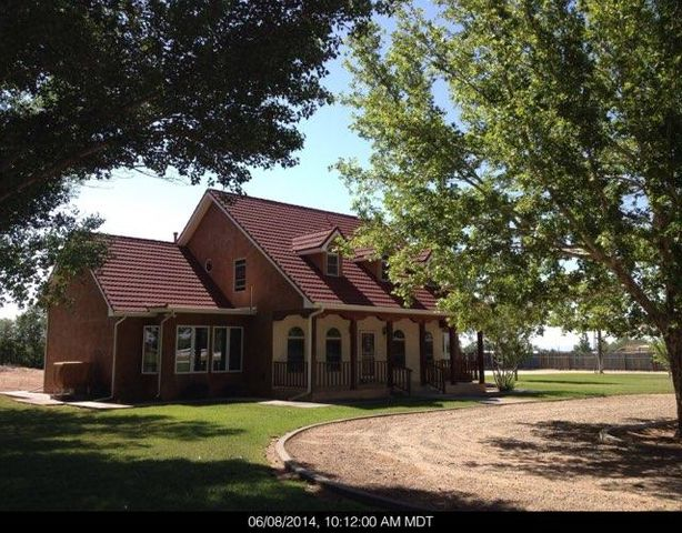 This Exquisite Estate  sitting on 6.77 acres of beautiful green groomed pasture.  Which features a 2000 square foot workshop/garage/storage that could fit an RV,boat & more . Home has 4 large bedrooms, Owners Suite is on the main level. Large bathroom with double sinks separate shower and garden tub with walk in closets. 2 Living areas, plus Formal Dining Room. Kitchen features  Granite counter tops, cooktop, double oven and plenty of cabinets and counter space for your Chefs Desire. The upstairs boasts of 2 bedrooms & another Owner Suite w/beautiful views. Enjoy reading your favorite book in the front porch or entertain in the back with your  family and friends! Bring your horses take a ride down the ditch bank, or enjoy the sunsets  jogging down the road.  Truly a master piece to own!
