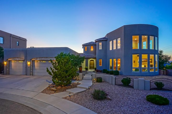 Amazing Custom Home in the La Cueva School District!  Great 2 story with master downstairs and open floor plan.  Kitchen features custom alder wood cabinets, granite and large island.  Master suite plus office/BR downstairs, 2nd living/loft upstairs and views of the Sandias from the kitchen, great room, loft & balcony! Enjoy beautiful sunsets and mountain views season round.  All on a large corner lot!  Hot tub stays.