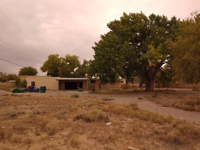 Bring the hammer and gloves because this is a Major fixer upper. 4.774 acres that dead ends to the property and is near the bosque, main house is 2340 sq ft without counting the basement, attached guest house/office is 1010 sq ft., detached guest house is 1010 sq ft. and 3,120 sq. ft shop. All buildings are currently not livable.