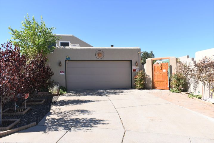 Price reduced on this nice home in the great location of Stonegate Village. Close to CNM, parks, shopping and is in the popular El Dorado school district. The updated kitchen includes Newer cabinets, granite countertops, splash guard & recessed lighting. Newer windows, custom bay windows, stucco, tile and wood laminate on lower level.  There is a Master Bedroom downstairs and upstairs. The 3rd Bedroom is on the main level. Huge Loft with Mountain Views has the potential to be used as an extra bedroom, game room, study/office. Located on a private, secure courtyard on an oversized cul-de-sac lot with fruit trees.   Bathtub/shower areas in both baths been updated. New Carpet in upstairs BR.  Ample sized storage area,  adjacent to the garage, could be pantry, workshop, multi-purpose room.