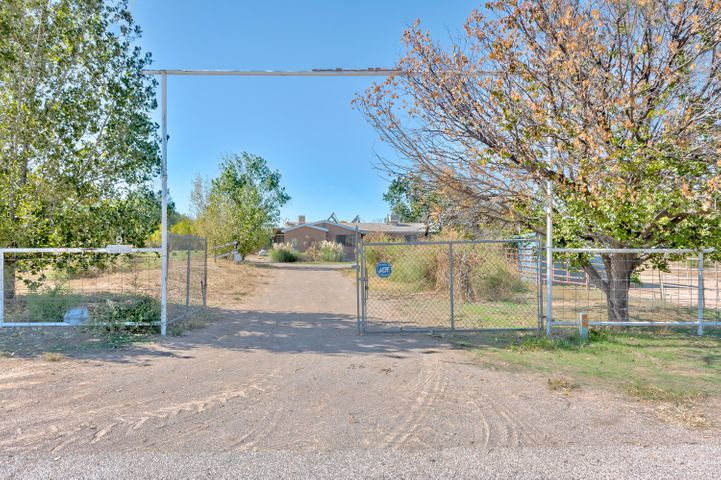 Ever want to own a farm? This 4 bedrooms, 2 bathrooms home sits on 3.9 beautiful acres with irrigation rights. Enjoy the grapes and fruit trees producing throughout the property. One bedroom casita is attached and could be closed off or open to the main home. Master suite, mother-in-law suite, office or anything else that fits your needs. Improvements include new roof (July 2018), new flooring throughout home (October 2019) stucco, air conditioning, furnace and hot water heater. Horse owners will appreciate the large hay barn, arena, corrals, and round pen. Enjoy the solitude of country life with easy access to 1-25, shopping and dining. Come and see this one before it's gone.