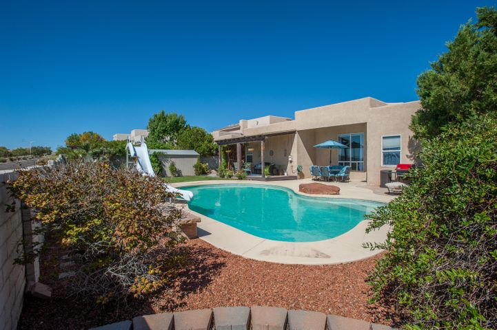 Enter into your own private oasis!  This incredible four bedroom cul-de-sac home checks all the boxes --- No HOA, RV Pad, Backyard Access, In-Law Suite with private entrance, Tile Floors in main areas, Mountain Views, Incredible In Ground Pool.   The backyard was made for relaxation! Covered sitting area, perfect for enjoying the balloons in the morning and sunsets in the evening.  Enjoy lounging in the beautiful in-ground pool, complete with a slide.  The home is equipped with Nest thermometer and Ring doorbell.  This home is a must see!  Absolutely stunning!