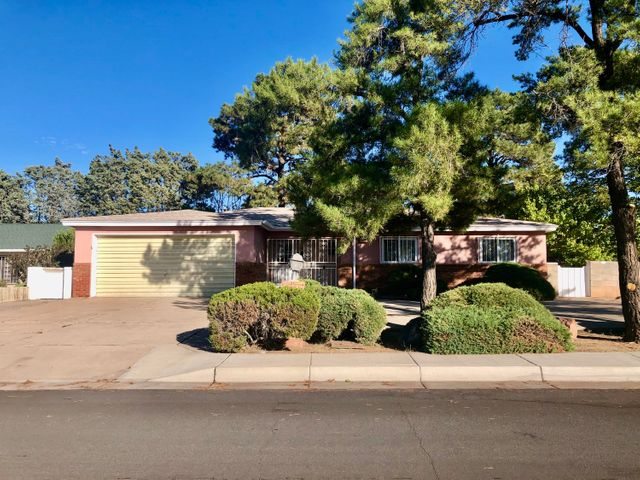 Welcome to the Fair West Neighborhood! This House has a Great floor plan. This House has 2 Big Living Rooms with Large windows to view the Swimming Pool in the back yard. The Kitchen overlooks the Second Living room that makes it feel really Big and has a Bar Top for people to sit. The Bedrooms are spacious with large closets. Walk into the Master Bedroom with a large walk in closet to the left. The Full Bath has a jacuzzi type tub and a shower. The Master has its own Glass Sliding door to the back yard. There is semi cirlce Driveway that would be convenient. Centrally located and close to Everything. UNM, Downtown, Uptown, Malls, Nob Hill, Air Force Base, Freeways etc. This house has Great Potential for those willing to give it a little TLC. A must See!