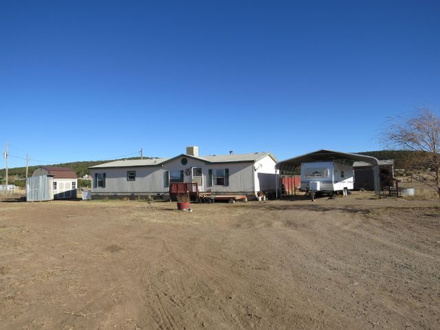 Are you ready to move to the country? THIS is your opportunity to own a piece of peaceful prairie in Edgewood, NM. The open style floor plan is essential for entertaining your friends and family. The large and stylish kitchen is delightful for those who love to cook! The bonus space off the kitchen is perfect for an office, breakfast nook, mudroom, or extended laundry/service room. This ENTIRE property is fenced and the frost free water hydrant is in the right location for your horses, chickens, or goats - so bring them! You'll be enjoying the lovely landscaping of roses, perennials, a cottonwood tree, and more before you know it! The private yard in the back is the true oasis - the ideal location to enjoy your morning coffee.