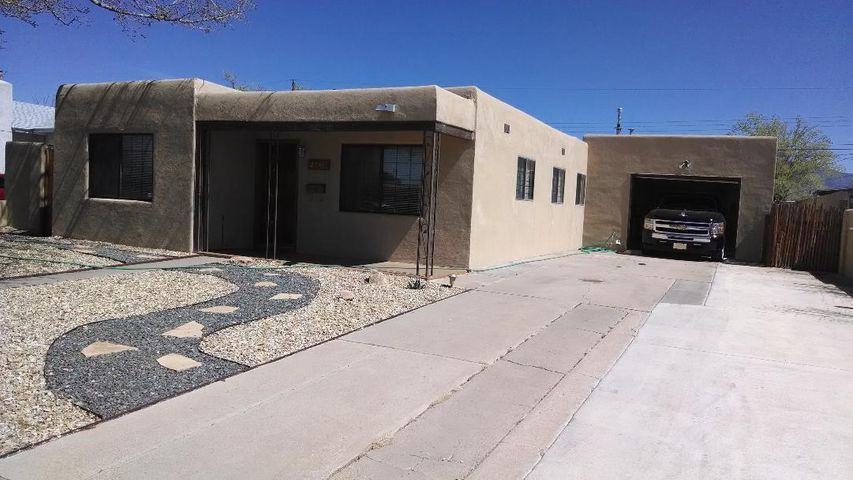 Great buy, close to shopping, parks, UNM, CNM and downtown. Updated features in this turnkey home that includes saltillo tile, carport, beutifully ladscaped backyard with patio, oversized drive-thru garage...this is a must see..call TODAY!