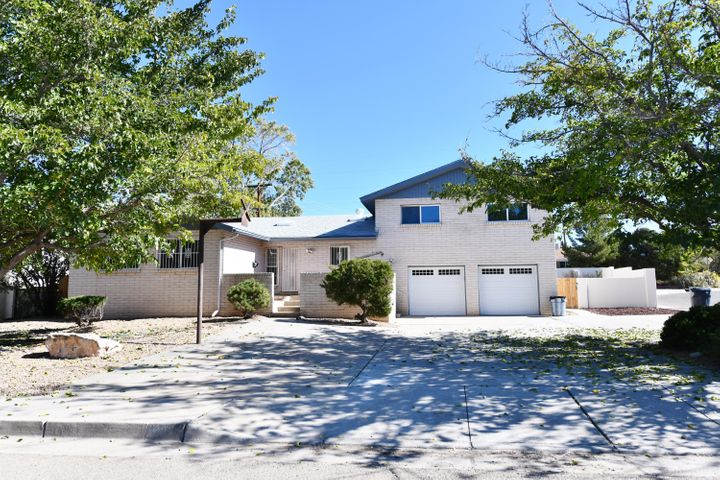 AMAZING REMODEL-WOW! Seller spent $150,000 on this stunning Home;5BDR (Includes 2-MasterSuites)/3 Full BATH+1 Half Bath, Oversized 2CG! Open floorplan with 2 living areas, spacious kitchen offering Granite countertops, plenty of cabinet space & New Appliances & Tile flooring.  This property is ready for move in. Updates include New Interior/Exterior Prof Paint, carpeting, Bathrooms-Granite countertops and sinks, landscaping, garage doors, Roof and Stucco (see Brag List). Awesome location- Close to Uptown, Coronado for shopping, variety of restaurants and transportation nearby! This is a MUST SEE! Note; Split level floorplan:  Lower Level-Garage bedroom & laundry room; Main Level-Kitchen, living spaces, & bedroom; and Upper level-3 bedrooms & 2 Bathrooms.