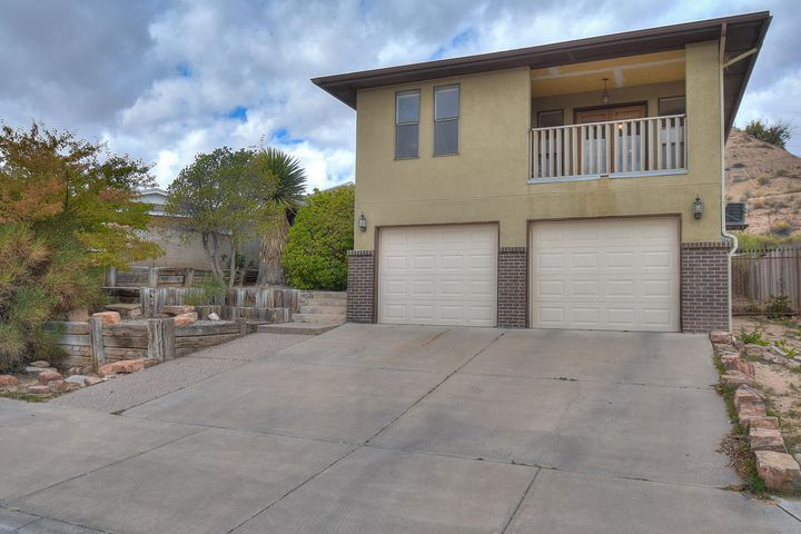Unique split level design home with great views of the Sandias, City and Bosque. Kitchen and dining room on main level.  Solid surface countertops, lots of cabinet space, pantry, island, stainless steel appliances including gas stove/oven, refrigerator ad built-in microwave in kitchen. Dining room could be used as second living area. Great room, master suite and balcony upstairs. Two bedrooms, full bath and access to the garage on lower level.  Hardwood, tile and carpet flooring, raised ceilings, ceiling fans, refrigerated air conditioning, whirlpool tub in master bath, fresh interior paint, lots of natural light. Large quarter acre lot, walled backyard, side yard access. New roof to be installed 11/9/19. Close to ABQ Biopark Zoo and Aquarium, Old Town and Downtown.