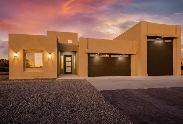Stunning brand new construction located on a large .85 acre property, surrounded by custom homes in the Terra community of Algodones. Home features 2,332sf with 3 bedrooms, 2.5 bathrooms and a 3 car garage including a RV garage! Great open floorplan with wood look tile and raised ceilings throughout. Beautiful living space hosting a gas fireplace finished with Venetian plaster and 2 slider doors offering the perfect lighting. Kitchen fit for a chef with custom cabinetry, granite countertops, backsplash, gas range, microwave, refrigerator and a large island with seating space. Luxurious master suite with a spa-like bath. Through the barn doors find his/hers sinks with a custom vanity, free standing tub, walk-in shower with glass enclosure and walk-in closet. Huge covered patio and backyard!