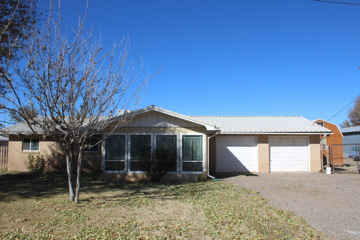 Beautiful country setting on 2 acres spread in the valley and a short drive to Albuquerque. Great family  home 3 bedroom, 1.75 bath,  16 x 16 sun-room, den with brick fireplace, 2 car garage. 20 x 40 Metal barn for your pets. Plenty of room for the animals, kids, and toys. Don't put off viewing this one!