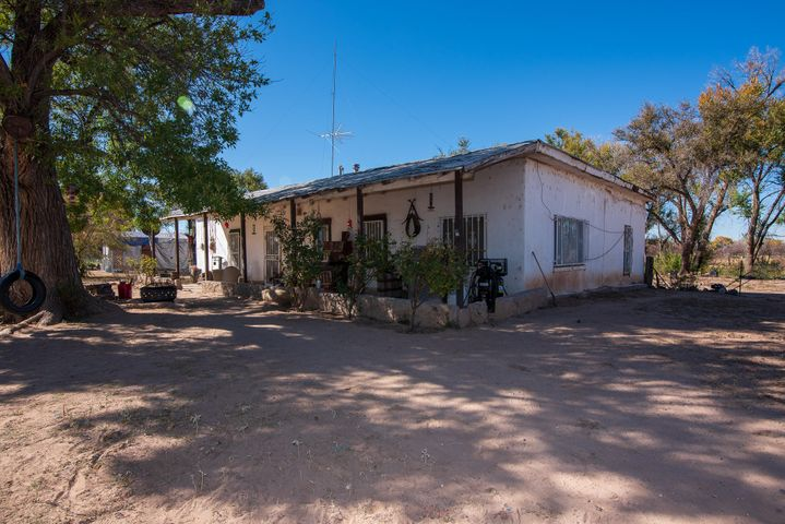 3 acre property with 2 homes located right on State Highway 47 in Belen (Adelino). 1986 sq. ft. Adobe 2 bed 1 bath home. Being sold As-Is, No repairs to be paid by sellers. Diamond in the rough waiting for new owners to make this place their own. Buy one house get one house for FREE! There is a cute little single wide on the property that conveys with the 3 acres and Adobe home. Property has a well for water and 2 newer septic systems (09/2018) .  Antique wood stove, 20' shipping container for storage and an upright piano also convey. Property is located adjacent to the wildlife refuge.