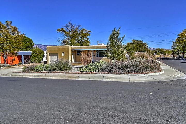 Fantastic Pueblo Style Home on a Corner / Over-sized lot, Two Spacious Living Areas and a single car garage with Garage Door Opener. Folks, this Home has side yard Slab Parking for Boat, RV or additional Autos. There is also the possibility for Backyard Access, Inside... the Home has been updated over the years, has marble tile counters, a Chefs Kitchen Stove, Original Hardwood Floors in Great Conditions and Storm  Windows. Schedule your Showing today and Let's get you moving.