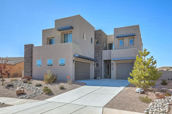 You'll be amazed at this popular DR Horton Leslie model in the beautiful Mariposa Community! The exterior architectural design will have you in awe as soon as you pull up!  This NM Green Built Silver Certified is extremely energy efficient!  Bring the in-laws as this home has 2 Masters, one on main level, and one upstairs! 2 additional bedrooms upstairs and a total of 3.5 bathrooms!  Main level has an open living room, dining room and flows right into a beautiful gourmet kitchen. Main level master has full on-suite bathroom! Upstairs you walk into a game room overlooking the family room below.  Over-sized laundry room upstairs.  Then a Master Suite that has a beautiful bathroom with separate garden tub and massive his and hers closets!  All appliances included, Samsung Smart Fridge, Washer