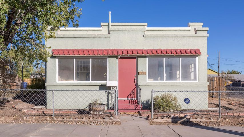 Welcome home to this amazing and historic Pueblo Revival home! Enter onto the front porch where the original details will immediately charm you! Recently refinished  hardwood Floors, beautiful raised Cove Ceilings give this space so much warmth and welcome! Original features include stained french doors-sash windows, french doors in both bedrooms. Recent updates include a new TPO roof in April of 2017, new water heater in in August 2018, new swamp cooler in May of 2016! This is a quiet part of Edo, located on the corner lot at the end of High Street. Walk to downtown, bike to UNM, and hospitals!!