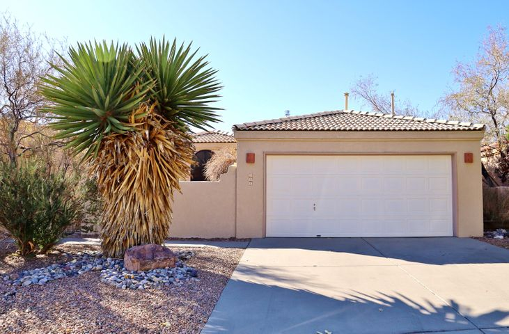 Close to shopping and I-40 access, quiet & secluded.  Views of Mt. Taylor and the Sandias.  Well cared for inside and out. Home features open floor plan, two spacious bedrooms, deck, courtyard, raised ceilings and more.  Get cozy this winter as the fireplace blazes.  Move in ready!