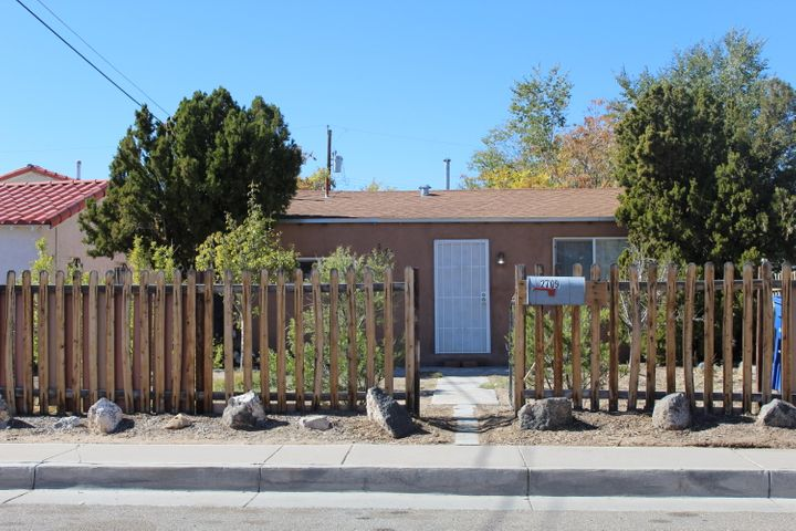 This beautiful casita is ready for its new owners!  This home was fully remodeled in 2009 to include roof, stucco, windows, flooring, air conditioning, and heating . . and has been excellently maintained ever since.  Conveniently located near the Big I, you will be able to transport easily to all areas of the city.  Back yard access gives plenty of room for storing all of your toys. With its current zoning of NR-LM, there are endless possibilities here.  So bring your dreams and come see this near North Valley gem today!