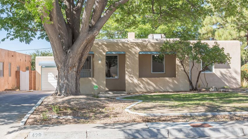 Walk to UNM, shopping, dining, entertainment & SO much more in ABQ's vibrant UNM/Nob Hill neighborhood... just a few blocks from Monte Vista Elementary School! This 3BR, 1BA is an updated classic featuring rich, refinished hardwood floors, freshly painted plastered walls & gleaming thermal windows throughout.  Kitchen w/newer cabinetry, granite counters, custom tile.  Bath w/custom surround, new vanity & more. Living room w/Fireplace & lovely window views!  Fantastic curb appeal w/ large shade tree and an inviting front porch. Private walled & landscaped backyard too w/an open patio, lawn, alley access &  secured gate for additional parking PLUS a detached garage/workshop! Security doors, newer heating and cooling (1-2yrs). TPO Roof.  Fridge, washer & dryer stay!  Schedule to see today