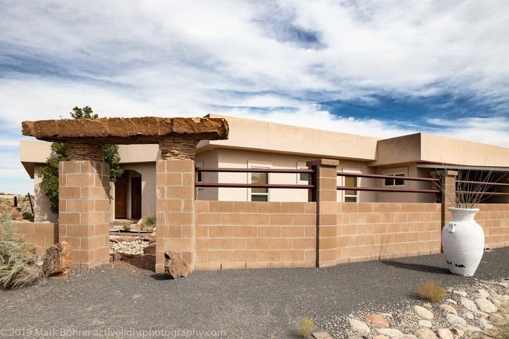 Great home, with extra large Shop. Relax in the hottub with views of the Sandias. Great for entertaining, with a large deck over the shop. Full sized Volley Ball Cort behind the home
