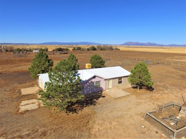 Get out and see this one before it's gone! Bring the horses to this fully fenced and cross fenced 10 acres on own private space with mountain views and endless blue sky! Ideal 3 bed, 2 Bath home with newer metal roof and cooler. Plenty of room to roam for the family and the critters. Country life at it's best with an easy commute to Santa Fe or Albuquerque. Natural Gas, no high propane costs!