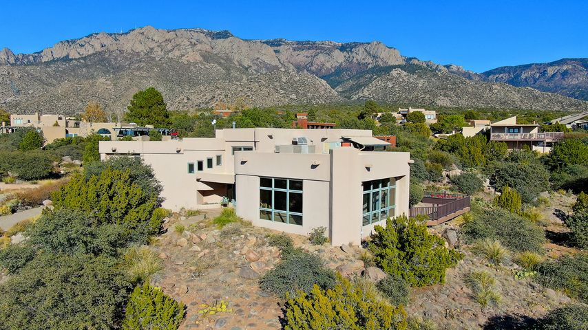 Magnificent best describes this exceptional contemporary pueblo style home with huge natural light, incredible mountain to Rio Grande Valley views and a mere two blocks to the National Forest. Dramatic architectural design and elevation providing incredible non-stop vistas in every direction- top of the mountain! Continually upgraded and updated including brand new advanced septic unit- huge pride of ownership. Chef's kitchen and master suite revival by Jade will impress any Buyer. Tremendous functional layout for entertaining with great indoor/ outdoor flow to enjoy serene outdoor living with monumental views. Wraparound decks and two covered balconies all set for the Balloons and gorgeous sunrise/ sunsets. This is special- don't miss it.