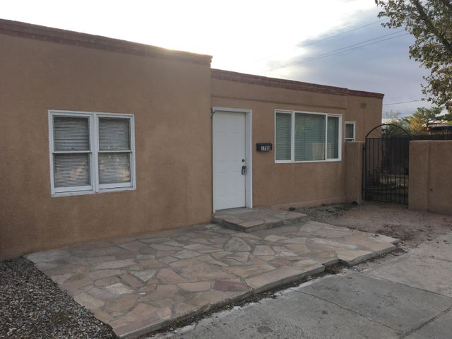 Fantastic location, close to UNM and UNM hospital.  This lovely 4 bedroom, 2 bath, 2 living area home has a huge backyard wiht large storage shed and gated access with huge concrete pad, ideal for RV, trailer or boat.