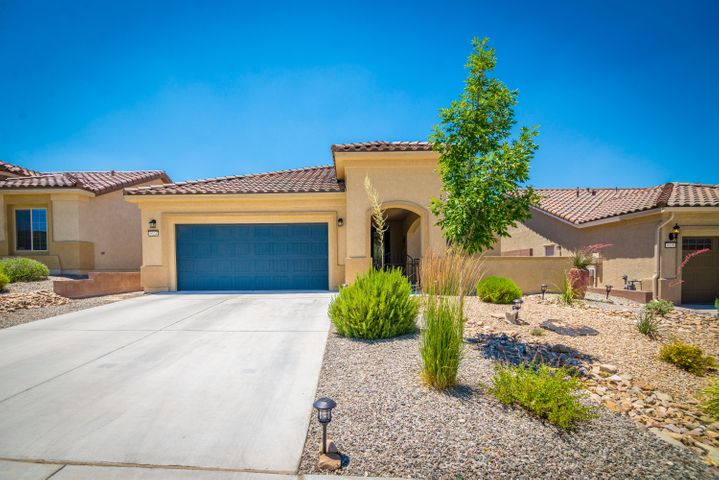 Beautiful Home in the Del Webb Active Adult Community at Mirehaven! This light and bright 2016 built home has 1880SF, 2 BR's, 2 BA's, Den/Office, 2 CG, Gated Courtyard, large kitchen with island and raised dishwasher, cooktop, built in oven, nice staggered cabinetry, stone back-splash, granite, beautiful 18'' tile, spacious outdoor  area w/gas fireplace and privacy wall! You will love the beautiful easy maintenance front and back yards! The custom backyard has an extended concrete patio, turf, rock water feature, plantings and has some Petroglyph views! Enjoy the Amenity Center which has daily activities, gym, salt water pool, tennis courts and pickle ball & much more! This community is tucked along the Petroglyph National Monument which has walking trails direct from the community!