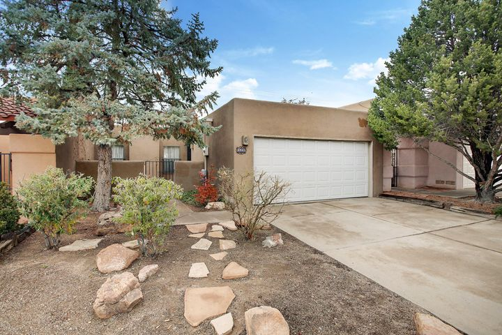 Welcome to this well maintained townhome in the convenient Academy Ridge Subdivision. This freshly painted and re-carpeted home boasts a large open living and dining area.  There is nice separation between the  two bedrooms.  Master has a large walk-in closet and full bath with access to the backyard.  Skylights located throughout the home bring in wonderful natural light.  The home has refrigerated air to keep you cool in the summer months. The 126 square foot sunroom is not counted in square footage.   This low maintenance yard includes a cozy courtyard entry.  New roof put on in 2018.   No HOA.  Welcome home.