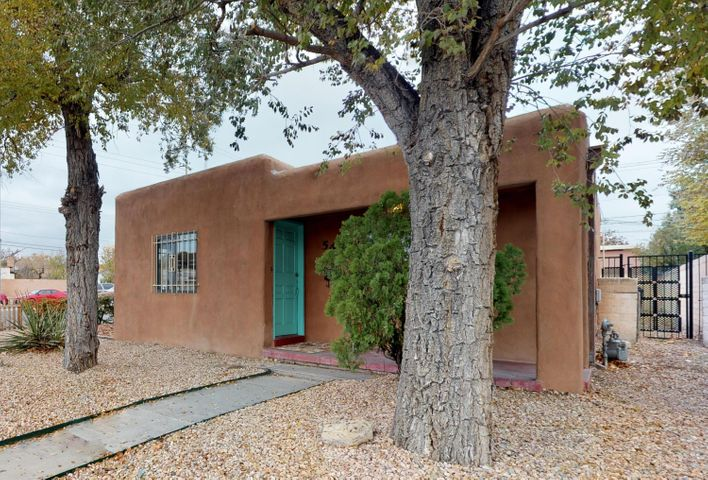 Attention Investors, Bargain Hunters, UNM parents!  Just blocks from Nob HIll, UNM & UNMH with a WalkScore of 77,  this great property includes a 3BR/2Full bath home + an attached 1 BR unit w/it's own kitchen and separate entrance!  Freshly painted home features  hardwood and tile flooring, cove ceilings, separated MBR w/it's own bath  & large closet.+ huge utility room.  Updates include:  Furnace, cooler, bath vanity, kitchen w/gas range, fencing, tile surround in all baths, lighting, security bars, refreshed stucco,  partial water  & sewer lines.  Ample parking area includes large storage bldg and will easily accomodate 4 cars.