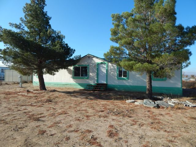 Lovely manufactured home on 1/2 acre!  1,456 sq ft, 4 bedrooms, 2 full baths.  Permanent foundation & durable metal roof.  Zoned for horses.