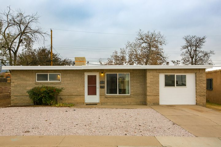 This home is a GEM in the heart of the NE Heights! Conveniently located to the city's center, Kirtland AFB, and I-40, this home boasts new flooring, fresh paint, a new cooler, spacious outdoor space with backyard access for your toys, and a lovely open layout. You'll want to call this home!