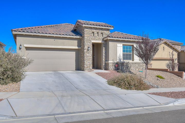 Beautiful,  1 yr new Hakes Brothers home within walking distance to Volcano Vista HS. The interior pops with wood look tile, granite counters, designer backsplash, kitchen island with seating space and upgraded appliances!! The master suite is a retreat! Bath includes walk in shower with tile surrounds, garden tub and double sinks! 10' ceilings throughout. This one should be added to your ''Must See'' list!! Shows like a Model.  In the family room there is a full glass sliding wall that opens to the outside...