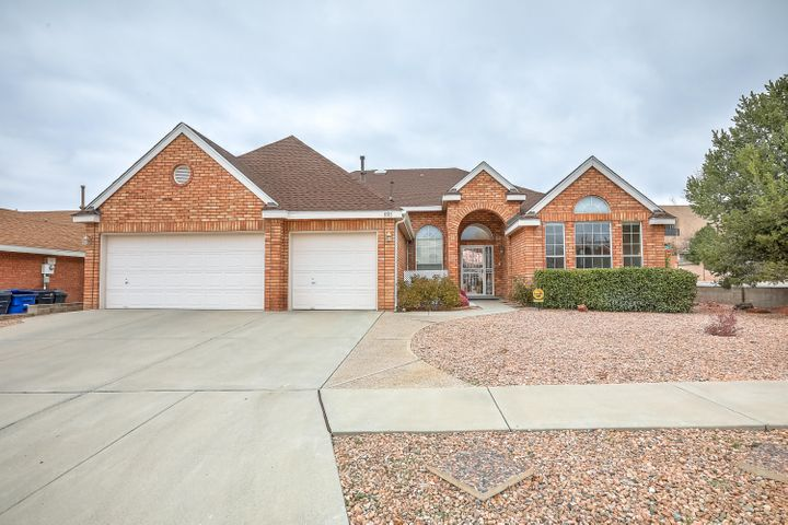 LOVELY SIVAGE THOMAS BRICK HOME! Enter to soaring 12' ceilings into this light filled one story gem. Large windows and updated flooring throughout. Formal living/dining room. Large kitchen with plenty of cabinets, walk-in pantry, nook, desk, updated lighting and new slider.Open family room with wall of windows and fireplace. Master suite with walk in closet, jetted tub, separate shower, double sinks. 3 more generous sized bedrooms with ceiling fans/large closets + 2 more bathrooms. Laundry room, 3 car finished garage. New roof 2019. Converted to refrigerated air 2017.  Newer 50 gal WH 2017. Professionally landscaped low maintenance back yard 2017. Hot tub negotiable. New Tuff Shed. Desert Ridge and La Cueva school district. Close to shopping, restaurants and parks! Open House Sat & Sun.