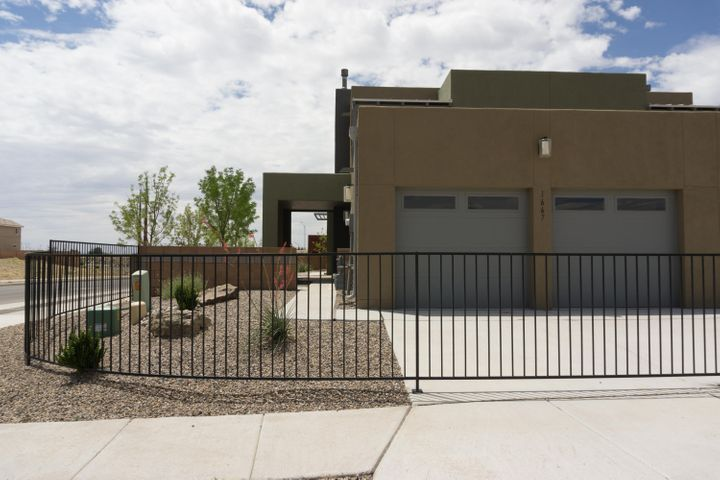 This is town home used to be a model home. It is beautiful and loaded with amenities. This is a fantastic low maintenance option for Volterra. East side living at West side pricing. This end unit is easy to show and has a very cute yard space. Fully landscaped.