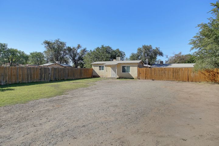 Southwest Valley Income Opportunity!! Or Inlaws Quarters!! Two homes for the price of one. .45 Acres.. Yes! PLUS+Open Vacant Lot..... Main house is 1236 sq.ft. with 2 Bedroom, 2 Living Areas. Kitchen and dining area. * wood-burning Fireplace * Covered Backyard Patio * Fully-Fenced yard! Casita on the back lot about 600 SqFt, one bed, one bath, living, dining area. and Storage shed. Vacant Land Lot included.Total .45 Acres. This is a property you must see! Casita current rent $750 monthly, on one year lease.
