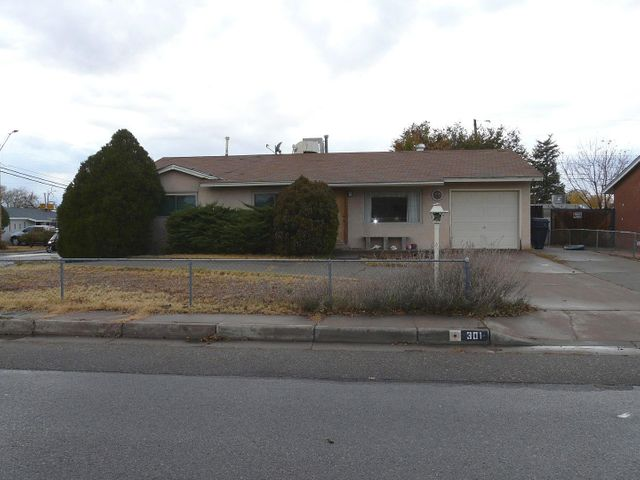 This home could be amazing with some handy TLC!  Good floor plan with three bedrooms and a large kitchen and huge family room with a wood stove!  Corner lot with the possibility of backyard access!  This home is priced to sell quickly!  Not a foreclosure...owner occupied.