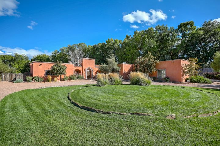 This single level, gated, sprawling Bona Terra Farms home sits on just over an acre in the North Valley. Just minutes up the road to the east side of town. The Old World European Designed home was built in 2004 by Ed Paschich Homes. The design features a large formal dining room with a convenient butler's pantry. A beautiful formal living , complete with an ornate designed ceiling to give the room an added European appeal. Gourmet Kitchen with dining space, and sitting room. Cantera Stone features throughout the home including, columns, fireplace, and exterior surrounds. Guest home (Not Included in Square footage of home) w/kitchen laundry and living/bedroom space. Exterior shower and gunite pool with slide. Enjoy the outdoor covered patios, playground, lush yard, and fire pit. Additional