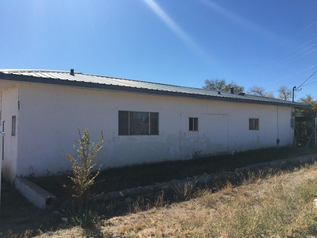 Great opportunity for UNDER $50k! Located in COMMERCIAL ZONING and could serve as a great property to live and work. Could also be a great in-law quarters with outside access in the master bedroom. Great location to live or invest in beautiful Mountainair!