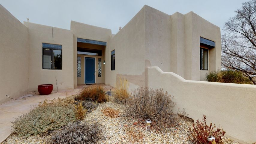 Enjoy the mountain views and beautiful sunsets from this Pueblo styled home in the heart of Edgewood. Generous rooms in an open floorplan with elevated ceilings invite you to relax. The interior has been newly repainted and has new flooring, both laminate and carpet, that complement the existing brick entry and kitchen. The bonus room can be used for an office, exercise room, or home entertainment center, or all three! Plus there is an enclosed sunroom with a hot tube off the master for more recreation space. Detached garage is wired and has a separate workshop space. New roof on both house and garage in 2019. Flagstone front courtyard and rear patio add outdoor living space. And a new septic! Paved streets, close to the freeway and 30 minutes from Albuquerque. Make it yours.