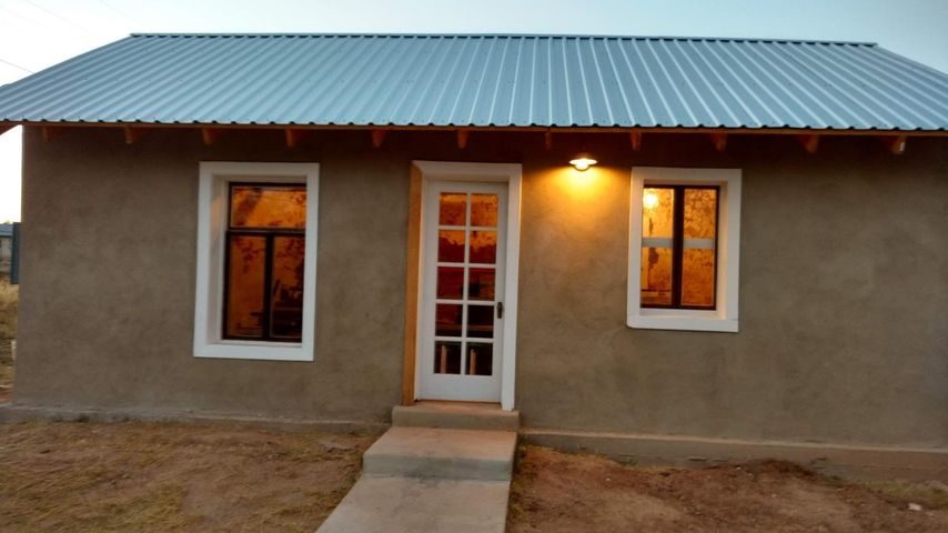 Amazing 1 room adobe home with many updates already in place. This is a great part of history that has been resurrected into a lovely home. Needs finishing, but has new electric, new plumbing, new roof, new stucco all within the last year or so. This would make a lovely full time home or a nice summer get away. The infrastructure is there for you to finish it the way you desire. Quiet corner lot in the small town of Mountainair. Mountainair has everything you need but away from the rat race of the big city. Make this your place in rural Southwest New Mexico in the Land of Enchantment!