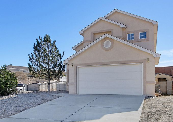 Immaculately cared for & loved 4BR, 3BA home, amazingly-priced in Las Maravillas ''Estates'' in Los Lunas.  Spacious living room w/soaring ceilings flows into the dining area w/built-in hutch.  A kitchen you'll love to cook & entertain in,  stainless appliances, tons of cabinetry & storage, & a center island accommodating informal seating.  Main floor BR w/adjoining bath could also double as a 2nd master BR or office. Spacious upstairs Master BR w/beautiful hardwood flooring--master bath with separate shower, jetted tub,  double vanity. Two additional bedrooms upstairs w/Jack and Jill bathroom.  Great floorplan has both public & private living spaces!  Large back yard needs your gardening skills, but includes a covered patio along/w a storage bldg.  Refrigerated air too! Don't miss!