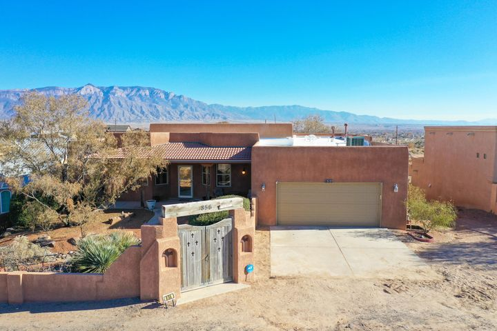 Custom Southwest Santa Fe style home on 1/2 acre with amazing Sandia views. Enclosed courtyard, 4 Bedroom ,3 Full baths, 2 car garage,  Refrigerated air, New Roof in 2017, Great Room Living area,   Kiva fireplace, large panoramic windows,  high ceilings, vigas, plant ledges, , ceiling fans, Efficient kitchen space,  kitchen island and large pantry. Split master floor plan features separation between the master bedroom. and secondary bedrooms.  Entertainers delight welcomes you to a large deck overlooking Gunite heated pool with a solar cover, outdoor kitchen, and hot tub just 5 months old. Added bonus is a 655 square foot basement (not included in sq footage) great for storage.