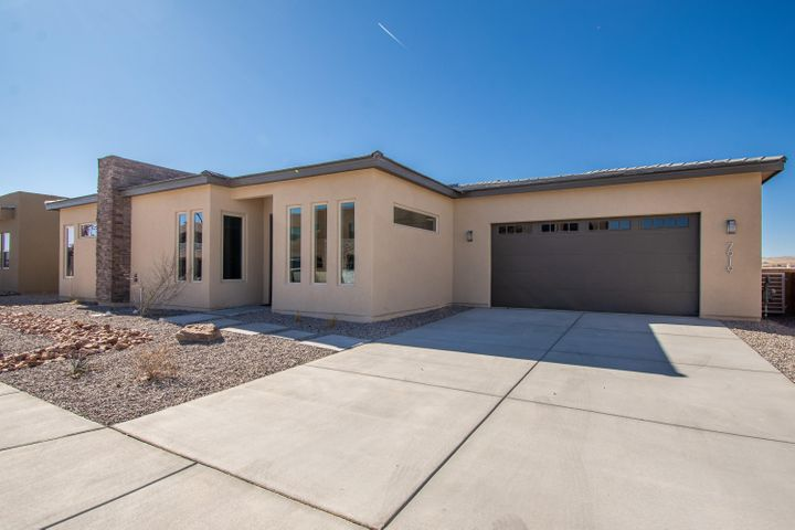 Gorgeous Rhett Ashley new build located in the Heart of the Petroglyph Estates community! Home features 1,801sf with 3 bedrooms, 2 bathrooms, 2 living spaces, and a 3 car garage! Beautiful wood like tile throughout the main living areas! Beautiful kitchen fully upgraded with white cabinetry, crown molding, backsplash, quartz countertops, slide in range, refrigerator, microwave, large island with seating and a pantry! Dining area right off of the kitchen. Living area opened to the kitchen, amazing views and perfect for entertaining. Master suite with trayed ceilings and a spa like bath. Bath hosts a free standing tub, a walk-in shower with custom surround, bench, dual sinks and a walk-in closet with built-in shelving. Private back yard fully walled with a large opened patio.