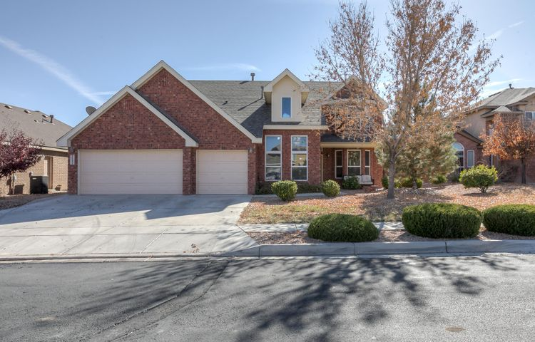 This gorgeous brick Pulte home has 5 bedrooms and 3.5 baths. Its located in Corazon at Cabezon which is a gated community and is tucked away on a cul de sac. The home has been beautifully kept with a large kitchen island, a fireplace, main level master bedroom, cathedral ceiling, and hard wood floors. The backyard is fully landscaped and even has a hot tub! Parks, walking trails, and a community pool all with in walking distance. Come and see it while you can, it won't last long!