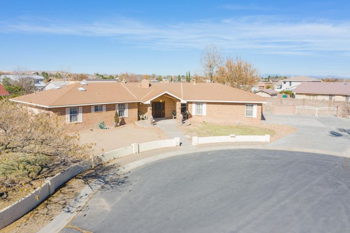 Check out this custom built opportunity in Corrals Heights! Initially, you are greeted by two lions guarding the entrance to your 4 bedroom 4 bath dream home. Walk in to find the welcoming two-way fireplace and a soothing skyscape in the living room.Down the hallway you'll find 4 bedrooms including a jack & jill bath. The master suite has  dual vanities  and walk in closets separated by a soaking tub and standing shower with dual shower heads.This half acre lot includes backyard access and outdoor storage. Inside you'll find a study, large laundry room, zoned radiant floor heating, and more! The 3 car garage has two doors. The 3rd bay has been converted to a room, but is easily returned to garage space if you need to expand the workshop.