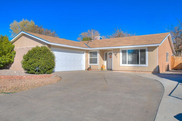 Wonderful 4 bedroom home in Sandia High School district! Enjoy the conveniences of the NorthEast Heights all around, in this light, bright and move-in ready house! Check out the beautiful laminate hardwood floors! All appliances are negotiable, making this one truly move-in ready. Wood burning fireplace in the den, with an open kitchen to entertain. Formal dining room, too!  Large concrete pad in back yard, and a huge 25 by 20 covered patio! Side yard access is available for toys or a trailer.  Owned solar- and with a solid offer, the seller will pay off debt leaving new buyer with no elecetric bill! This one won't last long! Call to see today