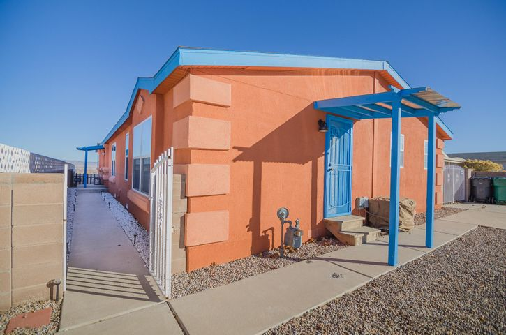Welcome to the Paakweree subdivision! This home has everything you've been looking for. Enjoy the city views that reach all the way to the Sandia Mountains from your backyard and watch balloons float by during the balloon fiesta. During the winter months cozy up to the beautiful fireplace in the huge living room. During summer days the refrigerated air will keep you nice and cool.  The kitchen has tons of cabinets and a built in desk. At the end of the day enjoy your master suite with a huge bath and soaking tub and a nice walk in closet. The other two bedrooms have their own private baths and one bedroom has its own private access. If thats not enough all the appliances stay and there is a tankless water heater. Make this home yours before its too late!