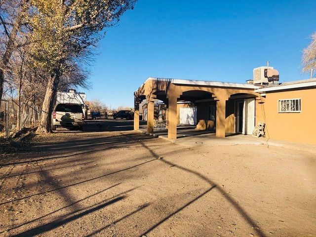 Great Investment property in the heart of the South Valley.  1 acre situated just minutes away from downtown Albuquerque. Home boasts hardwood floors, new  stucco. and  Extra Storage space.
