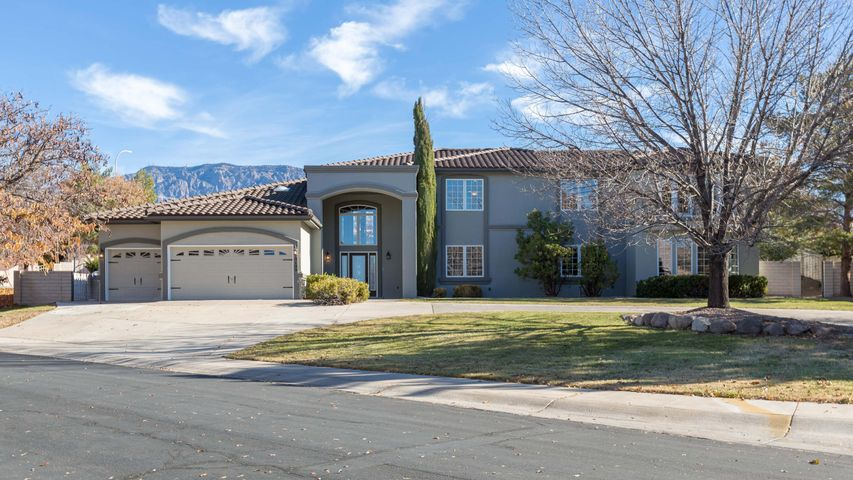 A spectacular renovation with custom updates you've got to see to believe. Features include: Breathtaking Sandia views, Grand Foyer and Stairway, Double Masters, Spacious Bedrooms, Massive Deck, Multiple Living Areas, a Private Terraced Low-Maintenance Yard with a spectacular Water Feature, a Dream Kitchen with an Eat-In Island! 24 hour Security in this Gated Community, This isn't your run of the mil Luxury Estate, this is a Chateau.