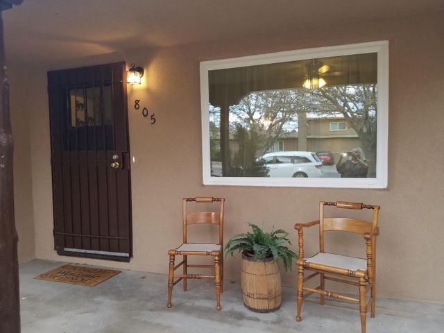 Lovely updated 3 bedroom, 2 bath home with new roof, new stucco, new kitchen cabinets with soft/ self closing cabinetry, new granite, tile backsplash, new stainless steel appliances with gas stove, new flooring, new thermal  double pane windows, new water heater, remodeled bathrooms.  Fireplace. Large carport for at least two cars, detached oversized 1 car garage with 120 and 240 voltage, shed with power. RV parking possible. Large backyard with rose bushes, grape vines and large trees . Front porch and large covered back patio.  Quiet neighborhood.  Close to UNM, Nob Hill and I40/I25.  Previous owner was famous NM artist, Pablita Velarde, whose works are exhibited in the Smithsonian and other museums.