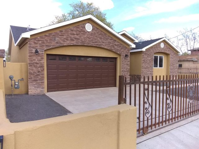 Custom Built home!! 3 Bedroom, 2 Full Bath, large 2 car garage! Recently finished in 2018.  Synthetic Stucco exterior with faux rock accents. Back yard access with two remote control gates.  Home sits on a fully fenced  corner lot, with a full landscaped yard. The interior features include Venetian plaster walls, vaulted ceilings, hardwood floors, travertine, custom cabinets, and gorgeous granite counters throughout! The kitchen offers a splendid granite island and Stainless Steel appliances. The master suite bath features granite counter with a double sink, separate shower and tub, along with a large walk-in closet. Easy access to I-25 Only minutes away from Downtown, Bosque walking /bike trails, Zoo, CNM/UNM,  airport and military base, Isotopes park, etc$500 closing cost assistance!