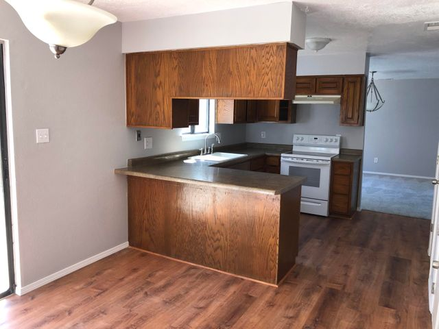 Need more Room? This beautiful updated 4 bedroom, 2 3/4 bath townhouse has it. New Flooring Carpet & Vinyl, Fresh Paint, New Garage Door and more. Home has living room, dining room, breakfast nook, good size bedrooms, large utility room and 2 car garage. Easy access to I-40. A lot of home for the money!  *RE-LIST*